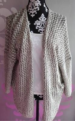 Black and white mix knit cardigan.  www.runwayomaha.com   Free Shipping - code- FREESHIP