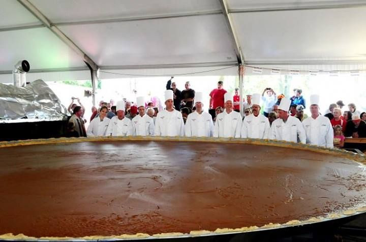 The (2010) world's largest pumpkin pie. 20' wide and 3699 pounds.