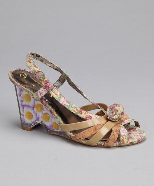 Fun, funky and flowery, this platform wedge easily commands attention as a savvy, chic centerpiece. Open toes, a decorative rope band and buckle closure all complete the lovely look of this shoe.3'' heelBuckle closureFabric upperMan-made soleImporte...