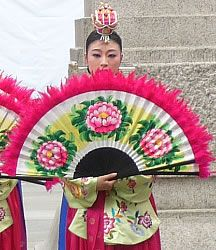 Buchaechum is a traditional form of Korean dance involving beautiful costumes and the elegant and skillful use of fans.