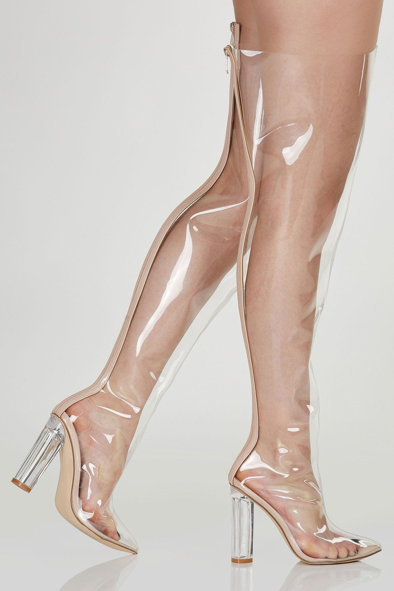 7de94deab0b See through thigh high boots with back zip closure. Pointed toe with clear  block heels.