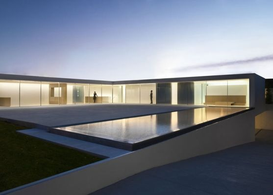 """Residential Architecture: Casa del Atrio (Atrium House) by Fran Silvestre Arquitectos: """"..Almost everything that goes on inside thishouse in Valencia, Spain byFran Silvestre Arquitectosis on show to visitors thougha transparent glass facade..The L-shapedhouse is entitledCasa del Atrio, orAtrium House,in reference to the glazed elevation and skylight that bring light into the eastern wing..A large living/dining room occupies this space and offers residents a viewout over…"""