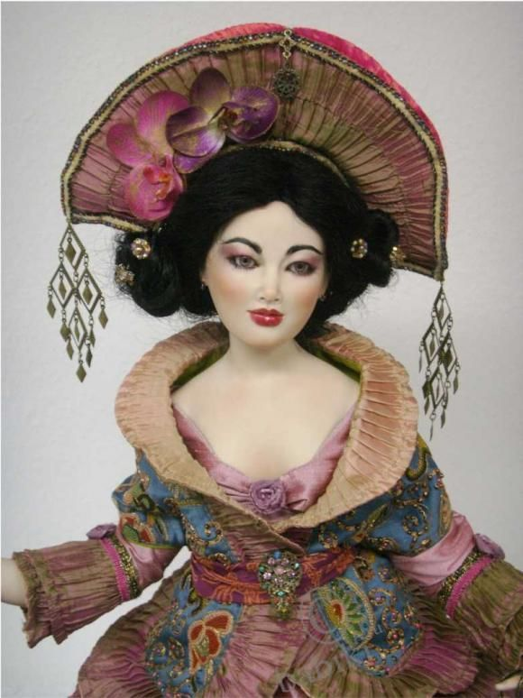 Gorgeous porcelain doll by Sylvia Weser.