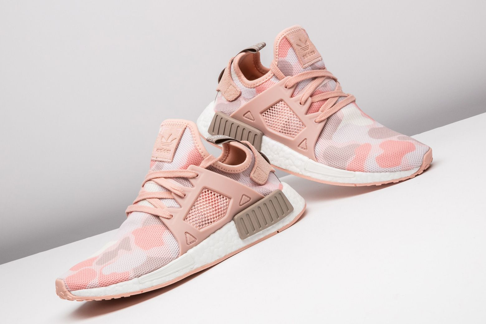 3a7981f273110 adidas delivers this NMD XR1 in pink duck camo for women who love the shoe.