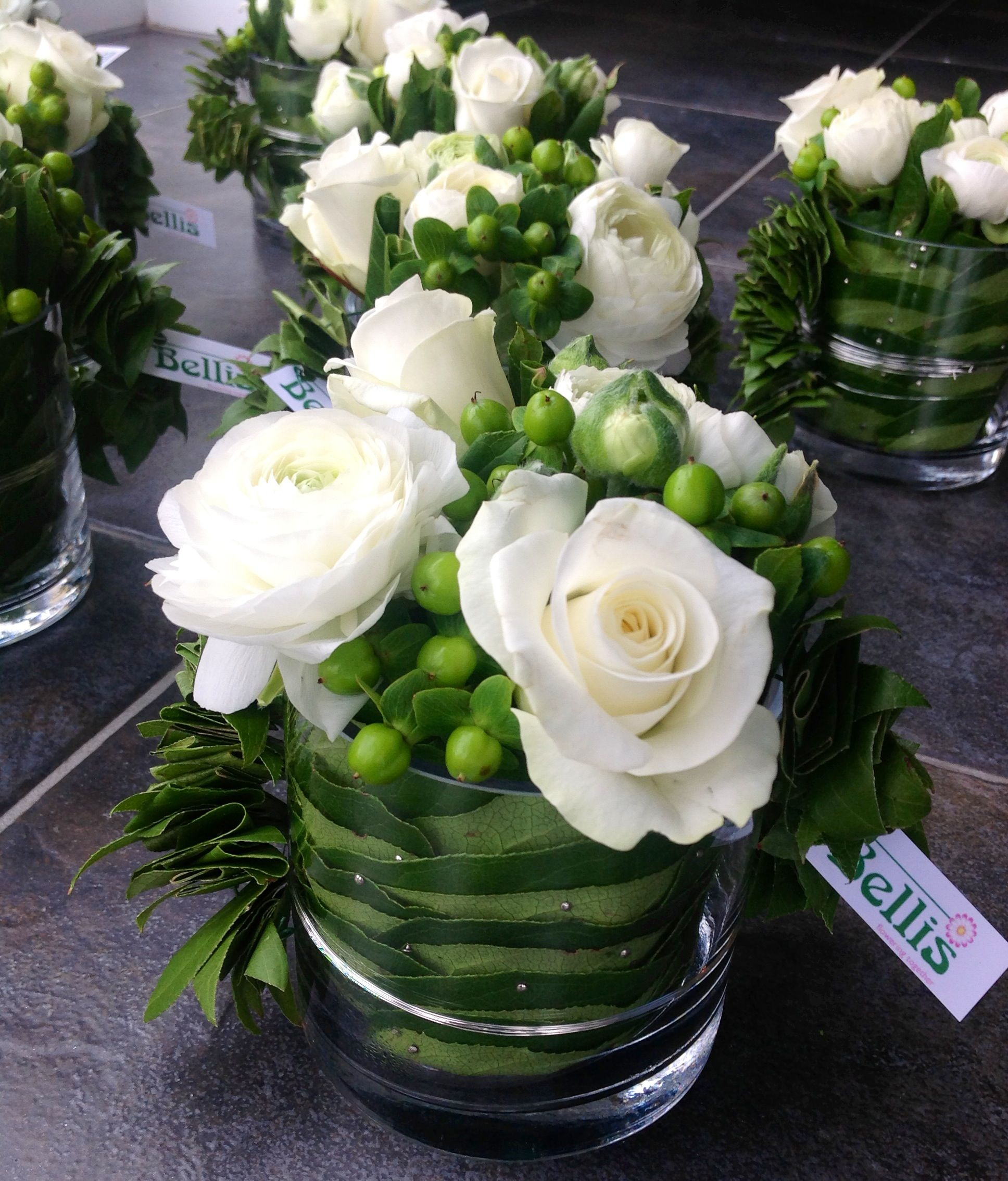 Modern table flower arrangement - white roses and St. John's wort   Uploaded and made by Bellis Bloemen (Westvleteren)