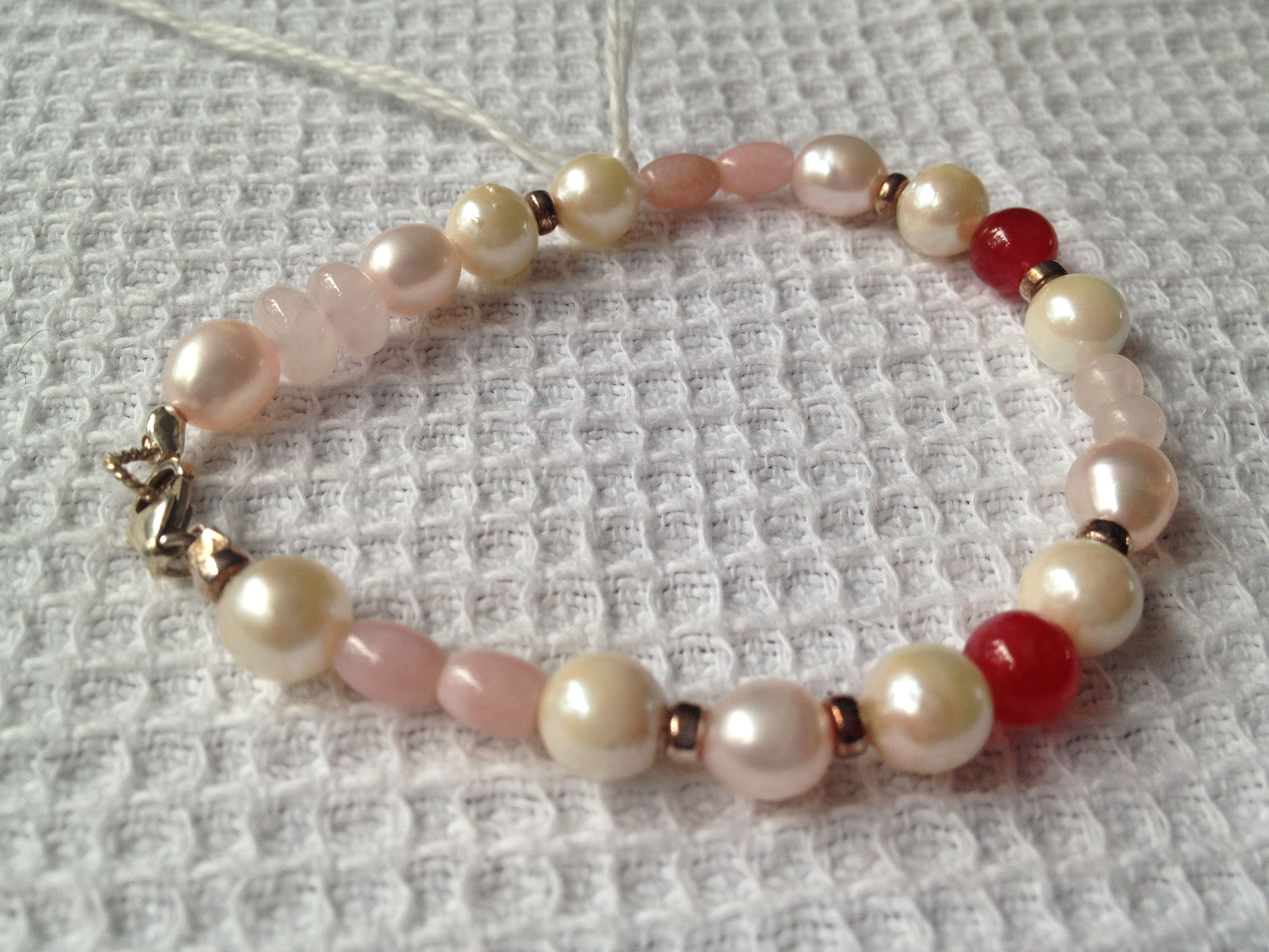 pretty bracelet --freshwater pearls,rose quartz,silver and touches of red agate. £16