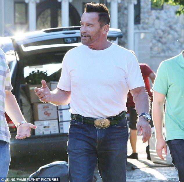 Arnold Schwarzenegger Sports Youthful Hairdo While Filming Arnold Schwarzenegger Schwarzenegger Mens Tops