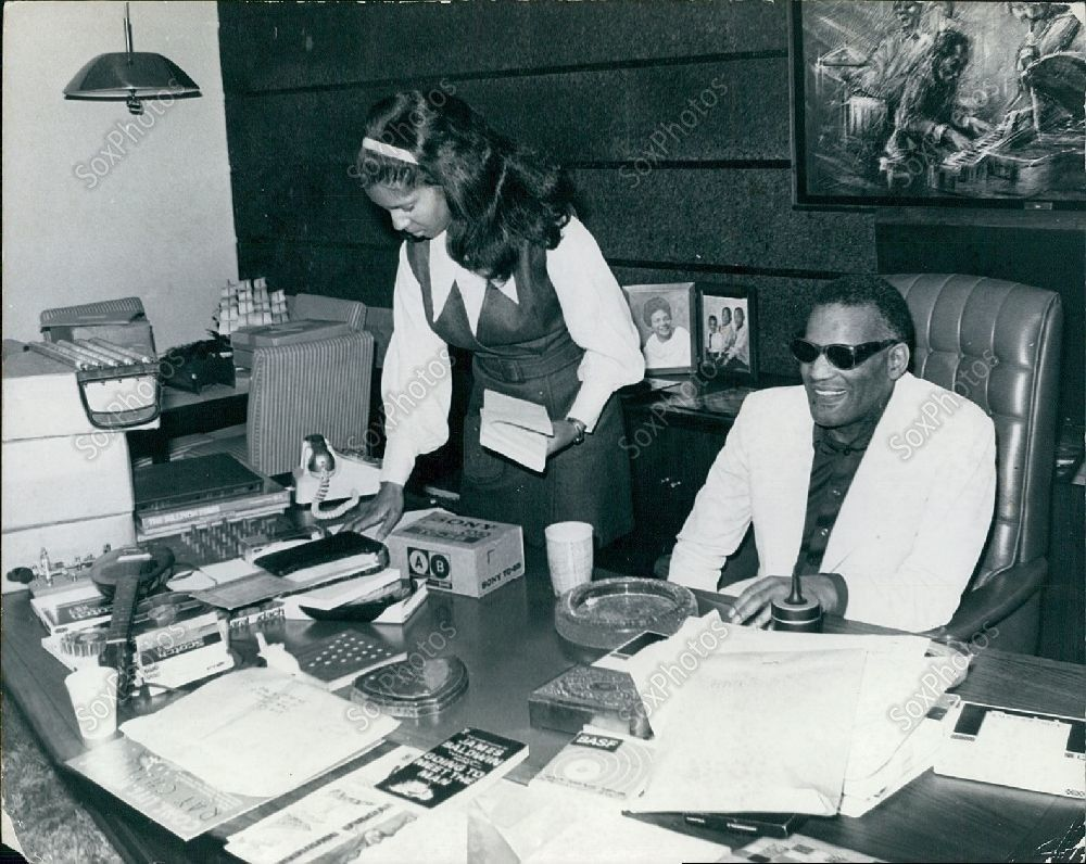 Ray Charles, posing at his RPM office in LA, early 1970s (wire photo).