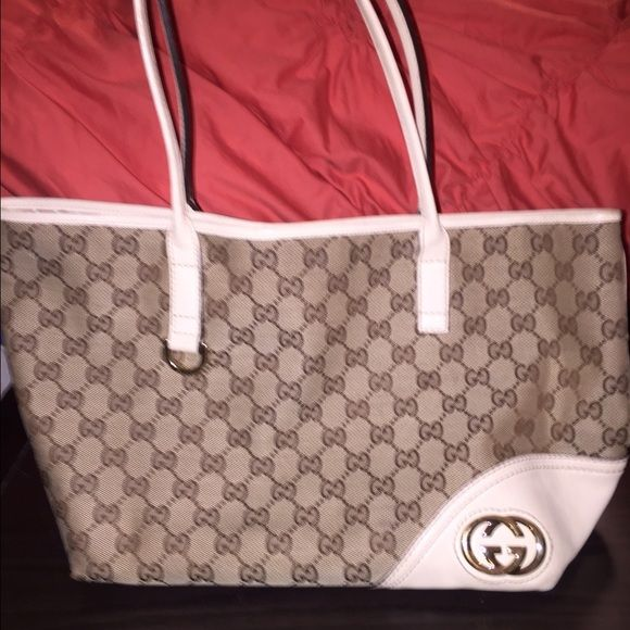 AUTHENTIC Gucci monogram GG Britt Tote This is a great small/medium tote that is in excellent condition with the exception of some wear on the corners.. See last pic.  Please feel free to make me an offer, as I'm negotiable. Gucci Bags Totes