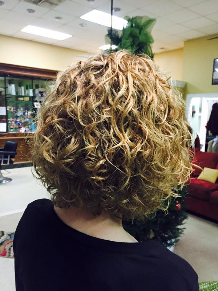 very nice medium length permed style with loose curl ...