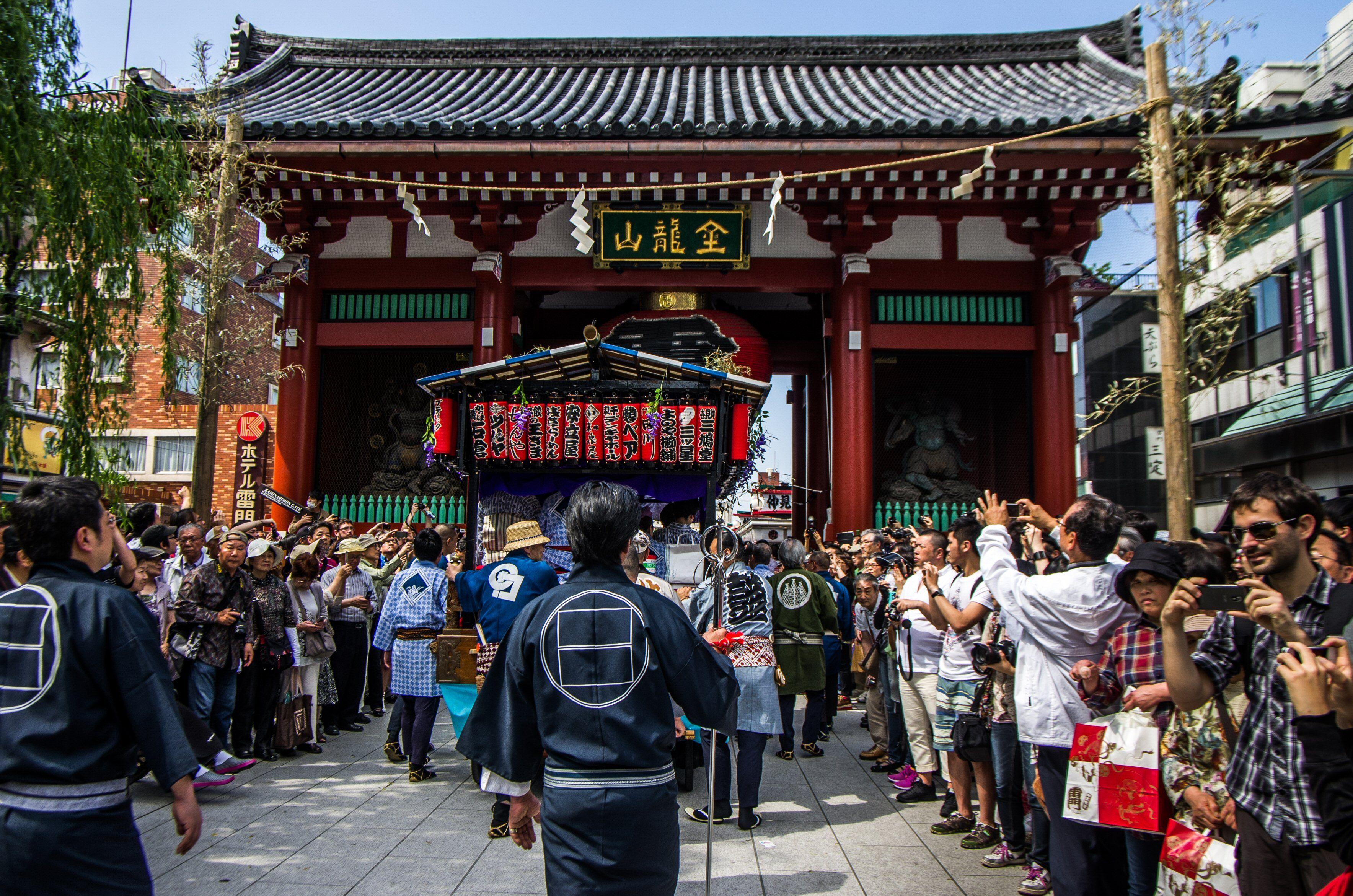 Asakusa Sanja Matsuri parade 13/17 The parade passing under the Kaminarimon gate -the huge chochin lantern-trademark of the gate is being collapsed during the matsuri to allow the floats and omikoshi to pass. #Asakusa, #Sanja, #Matsuri, #parade, #Kaminarimon, Taken on May 16, 2014. © Grigoris A. Miliaresis