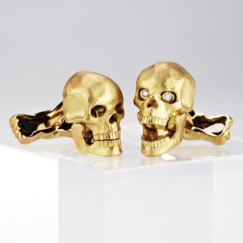 Skull head cufflinks... And also with diamonds at its eyes.     Deakin & Francis