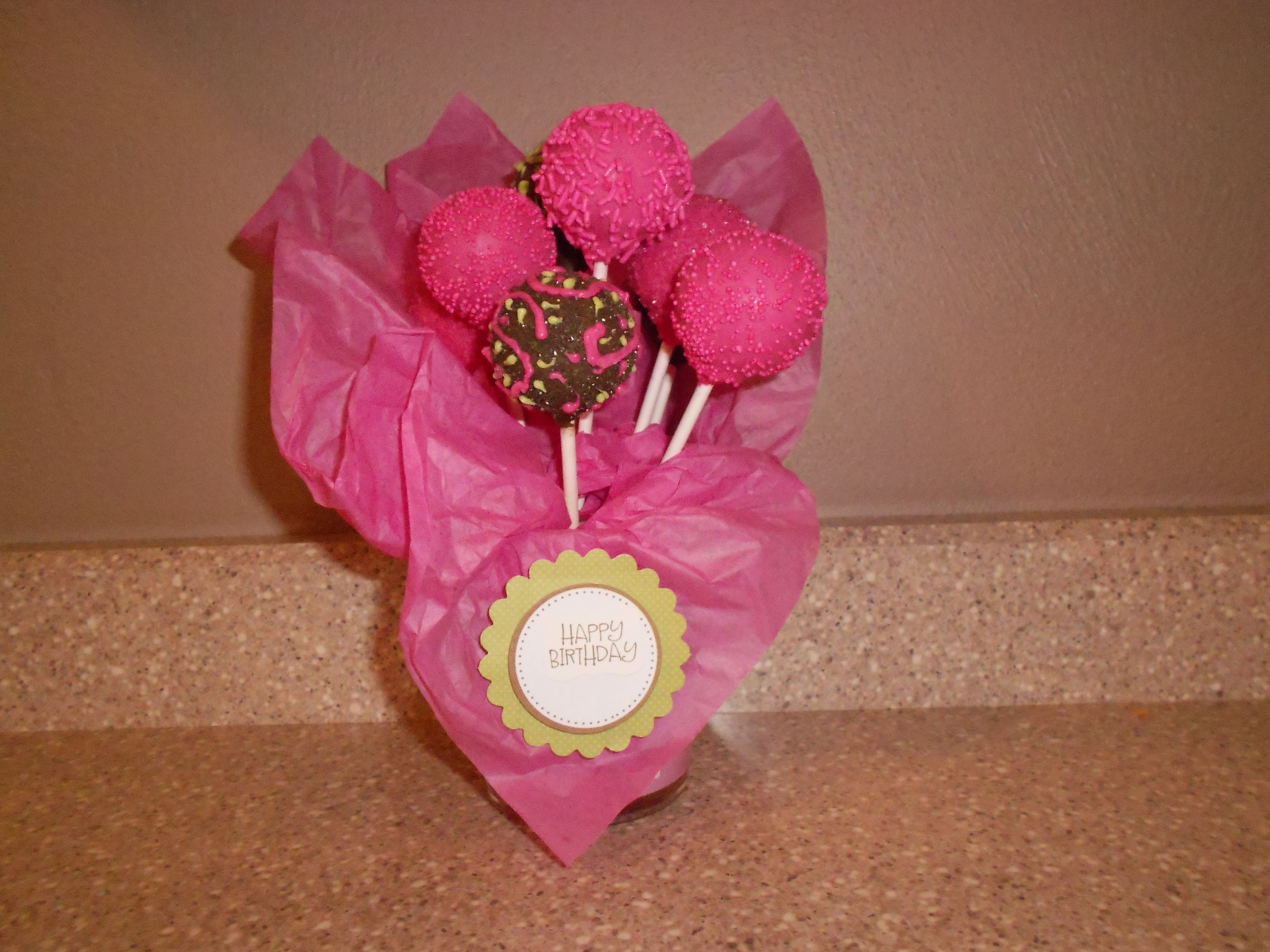 Shades of pink and brown chocolate cake pops!  Made by Susan Moulden