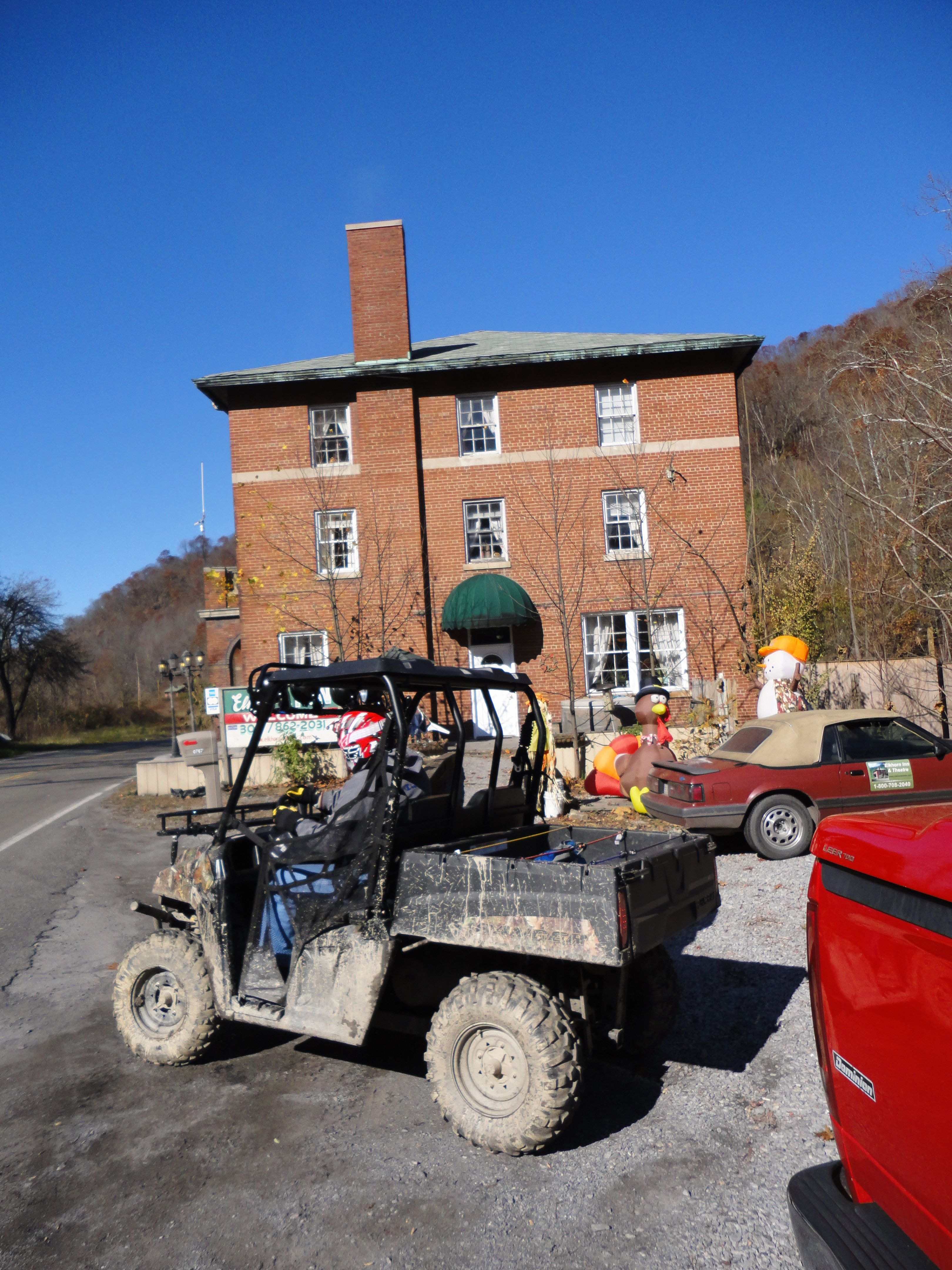Ranger in front of the Elkhorn Inn at Landgraff WV