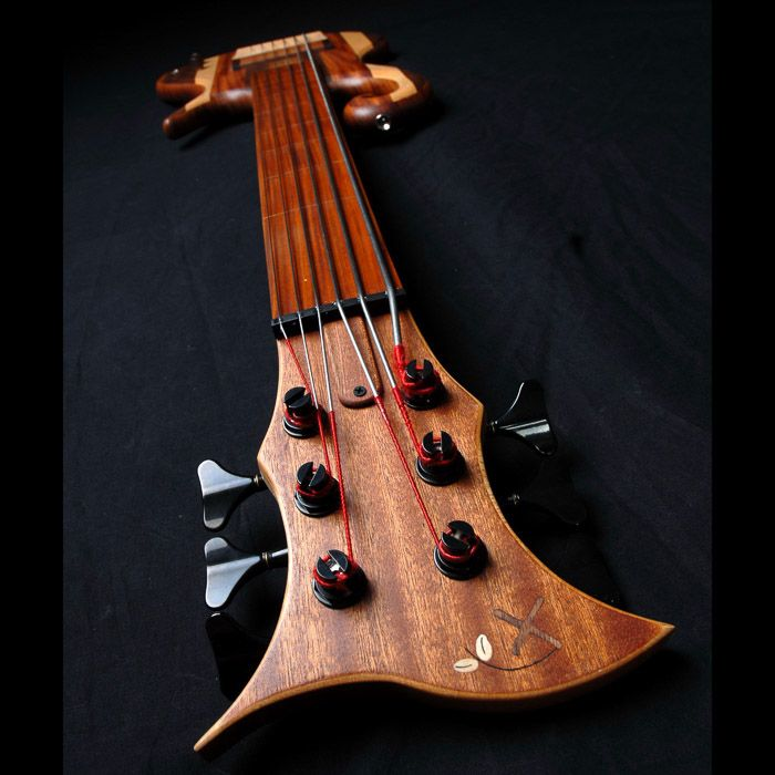 Headstock Front And Xylem Logo Inlay Of The 6 String Fretless Bass Guitar