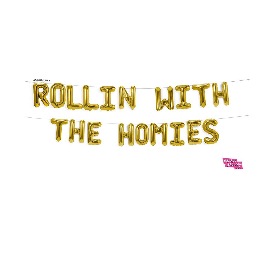 """These block phrase script """"Rollin with the Homies"""" balloons are a great addition to your thanksgiving, Friendsgiving, Christmas, Friendsmas, birthday, or house warming party. Also pairs well with our """"Rollin with the Homies"""" hip hop collection latex balloons. Let your people know that they aren't just your friends, they are your homies! Create a truly magical party moment by using these script balloons to add an instant backdrop to any wall! Suspend them from ceilings or secure with mounting tap"""