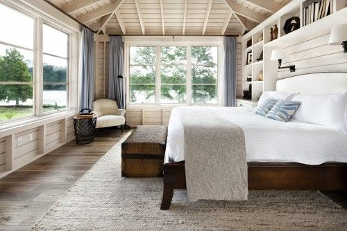 The large open windows make this room feel more like a sleeping porch.  The painted wood adds a feeling of simplicity.