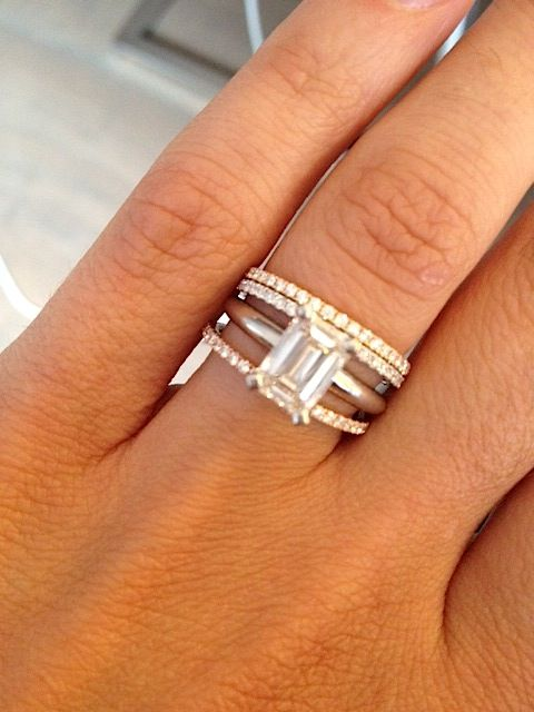 thin bands with emerald cut solitaire ring