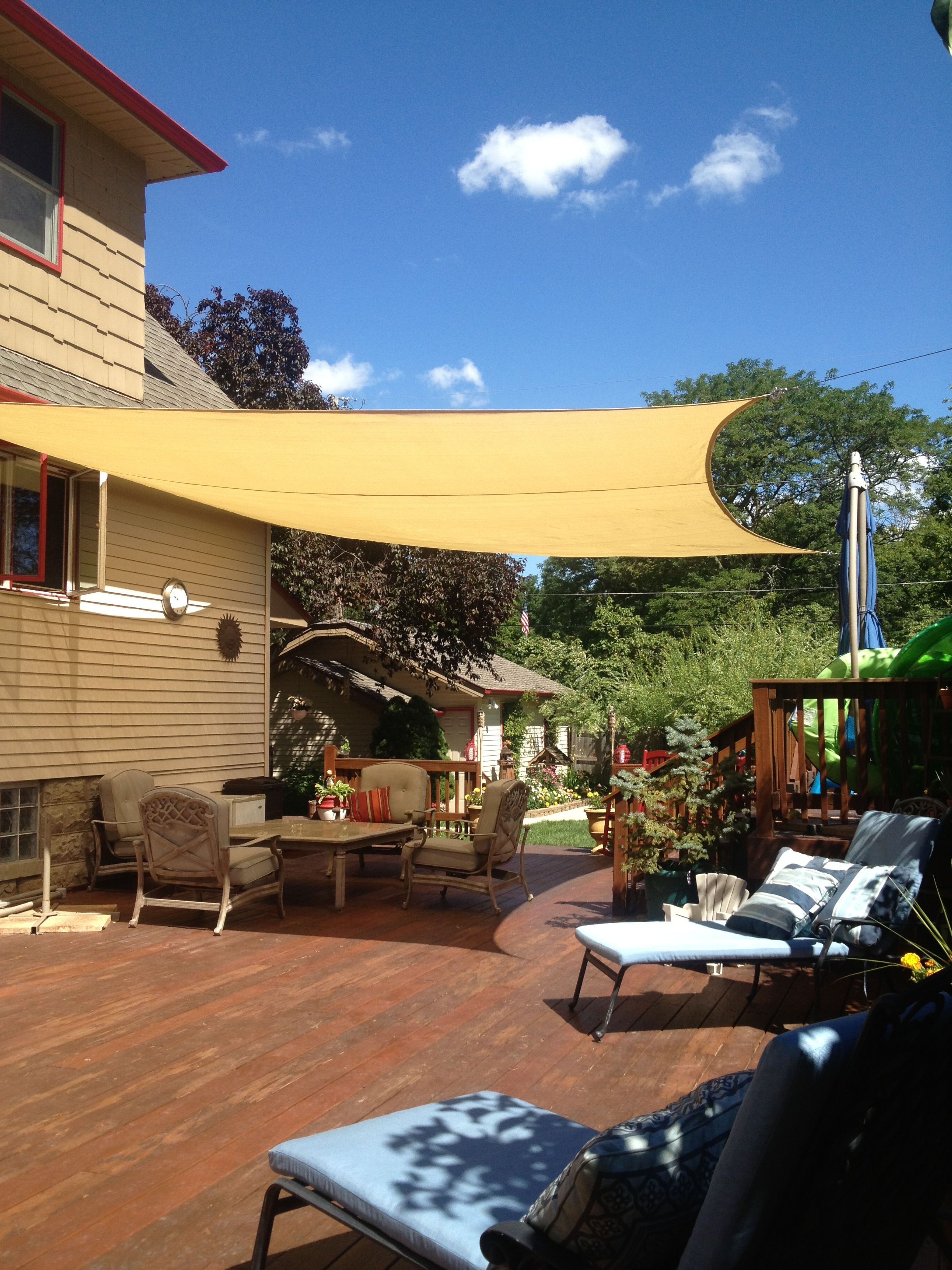 steel posts for shade sails on sail shade for deck that extends off house 18 x18 attached to hand crafted steel post no future rust issue and or bowing steel deck shade patio backyard pinterest