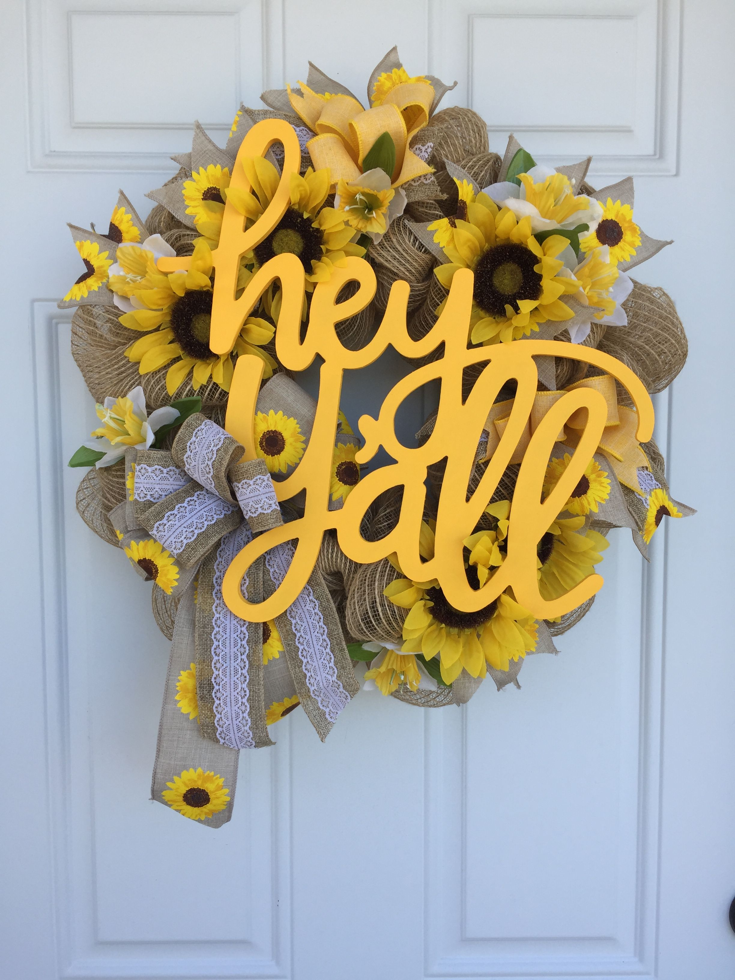 Photo of Hey her sunflower wreath. Custom design from Southern Sun Designs.