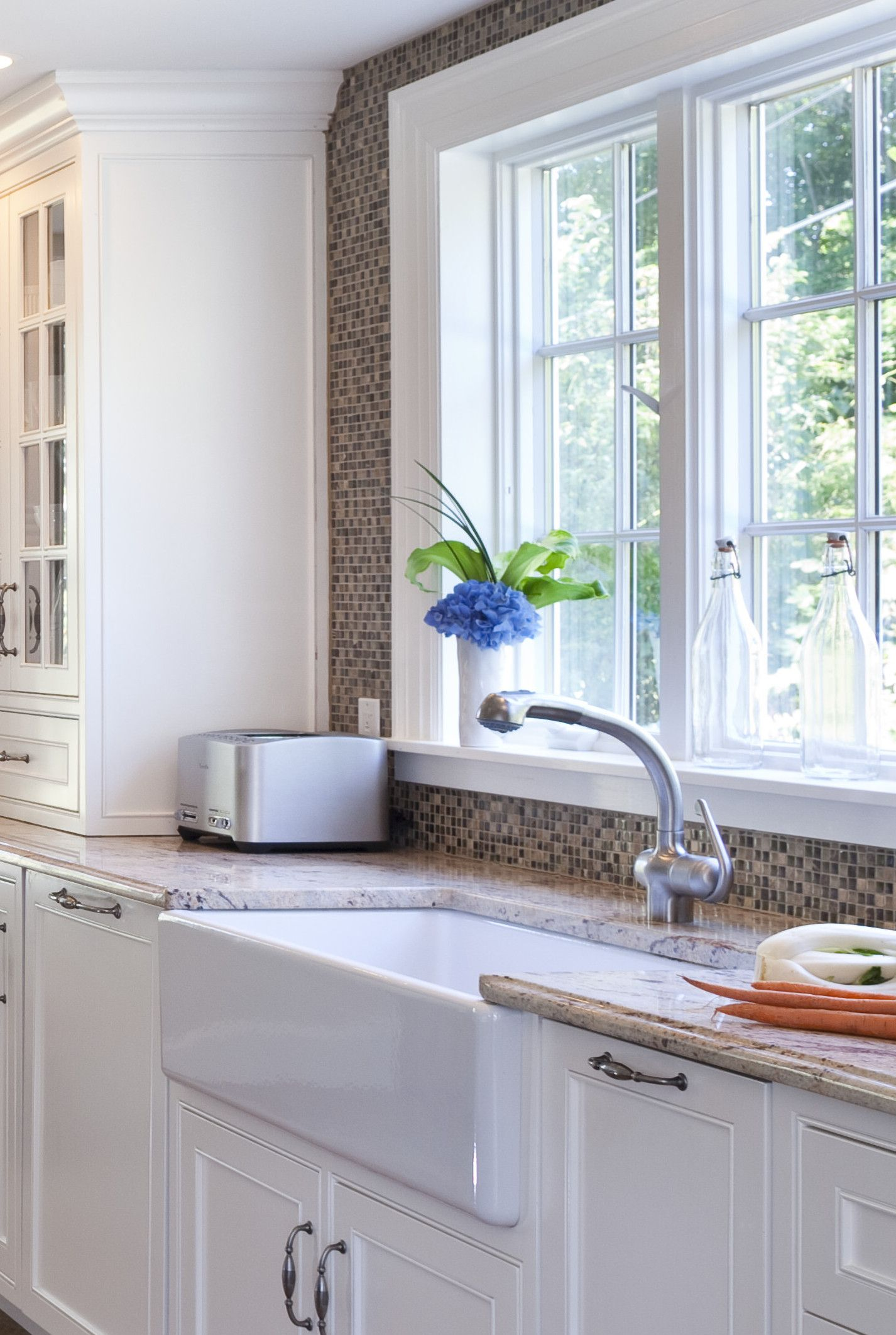 large white porcelain farmhouse sink makes wash up breeze this crisp glass tile also stainless steel stove and range provides contemporary touch