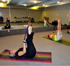the raised feet pose in yin yoga  yoga strap easy yoga