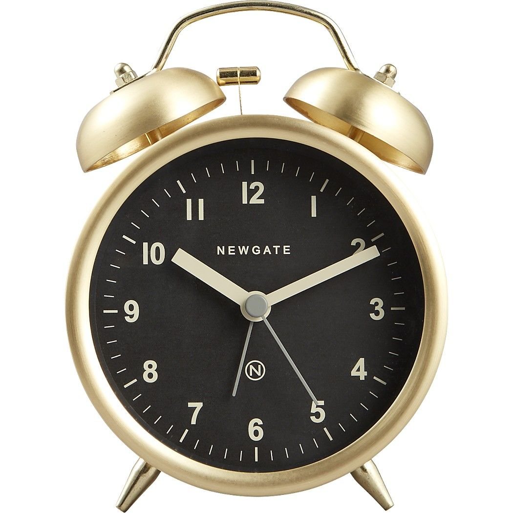 Shop charlie gold alarm clock.   Rise and shine with this modern take on an old-school wake up call.  Brushed gold finish juxtaposes a black face with white numbers perched on two tiny angled legs.  Dresses the bedside table, dresser or bookshelf.