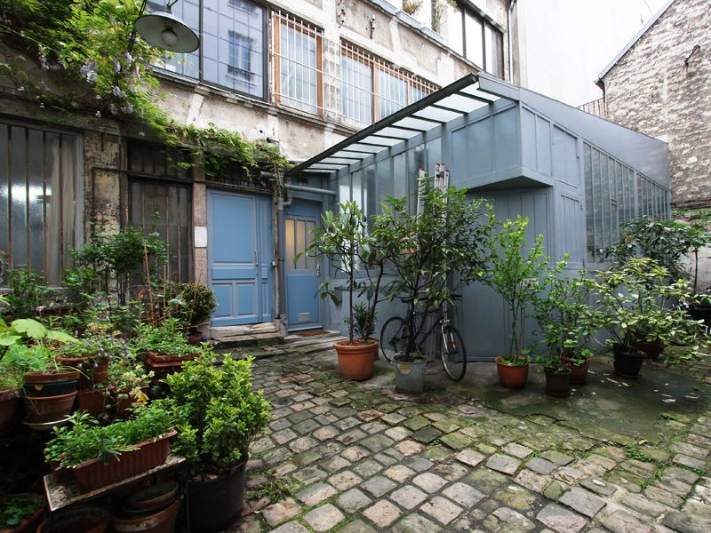 Paris loft sous verri re sur cour fleurie avec images Verriere jardin