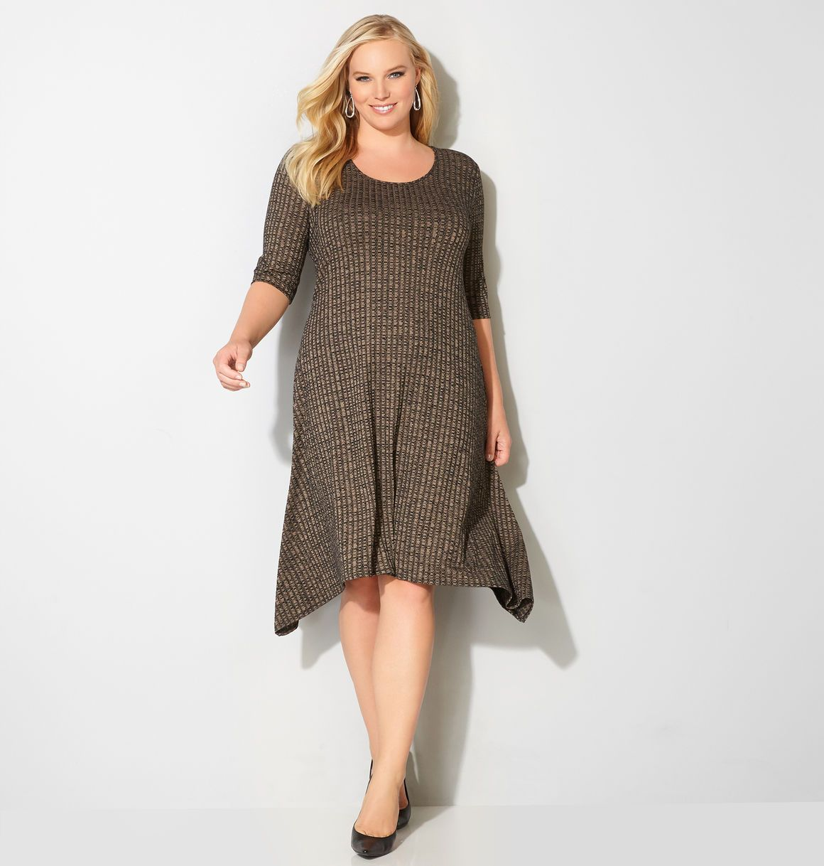 Head to the office or dress up for a party with this pretty new plus size Neutral Sharkbite Sweater Dress available in sizes 14-32 online at avenue.com. Avenue Store