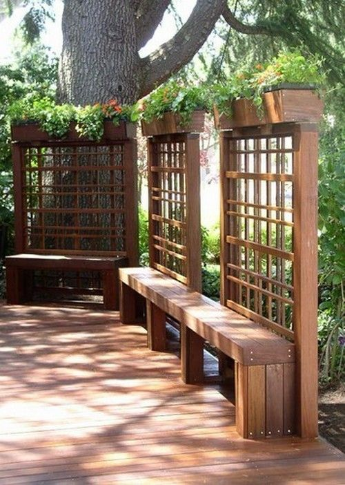 Add a garden box on top of your patio wall partition.