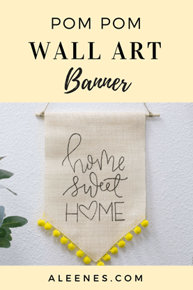 DIY pom pom wall art banner - how to make a canvas banner with pom pom trim using Aleene's Fabric Fusion glue - CLICK for the how-to ... #TackyGlue #Aleenes #crafts #DIY #HomeDecorDIY #HomeDecor #DIYDecor #DIYHomeDecor
