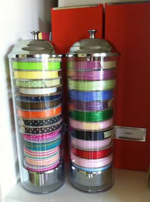 Brilliant!!  Get straw holders to store ribbon spools! Just pull up the top and the whole stack comes up, no need to remove spools to use! I also love how you can quickly see what you have.