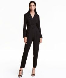 Black. Jumpsuit in woven fabric with narrow lapels at front, wrapover front section with a concealed snap fastener, and long sleeves with slits at cuffs.