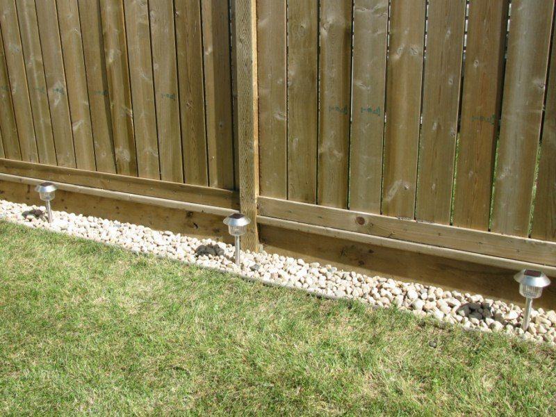 kelly loves stuff rock border along the fence for the