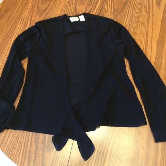 """Black knit jacket with tie front, size S Black Chico's Travelers Knit jacket, Chico's size 0 (about 6-8). 95 PC acetate, 5 PC spandex. Soft non-wrinkle fabric is weighty and drapes nicely. 15"""" across shoulders, chest approx 36"""", waist (tied) is approx 37"""". Chico's Jackets & Coats"""