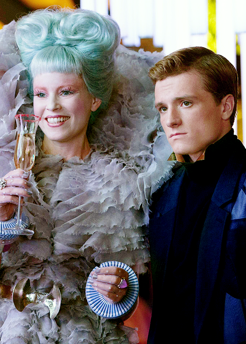 Catching Fire still shot of Elizabeth Banks (Effie Trinket) and Josh Hutcherson (Peeta)