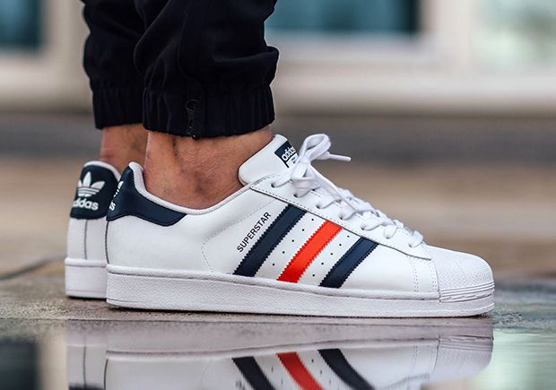 pretty nice bb942 86e53 The adidas Superstar heads to France for this latest colorway, featuring red  and blue stripes against a white leather upper. Apparently paying homage to  the ...