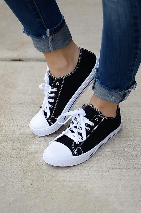 ac8302c2bc17 These lace up sneakers are a closet essential all year round! Also  available in gray. Runs true to size. Color  black. Made in China.