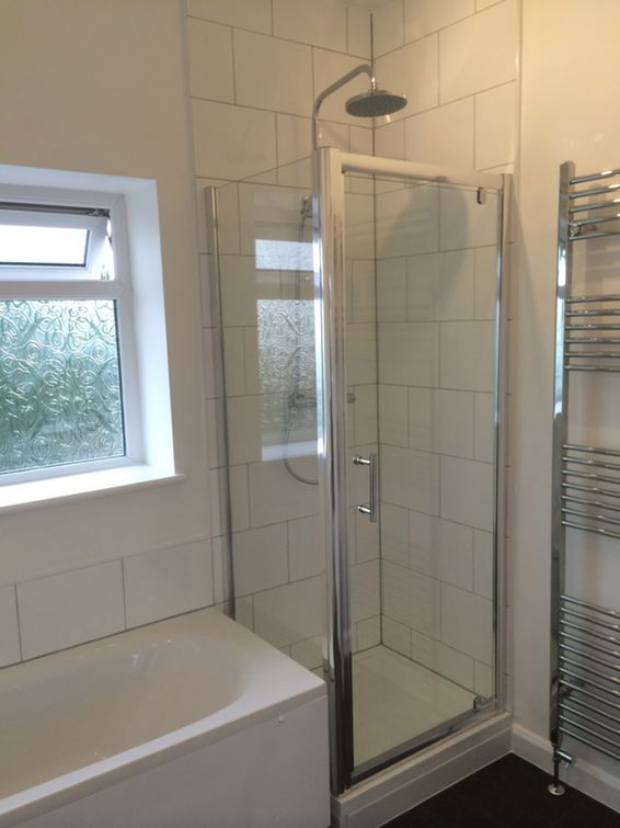 Shower Enclosure At End Of Bath in a bathroom installation by UK ...