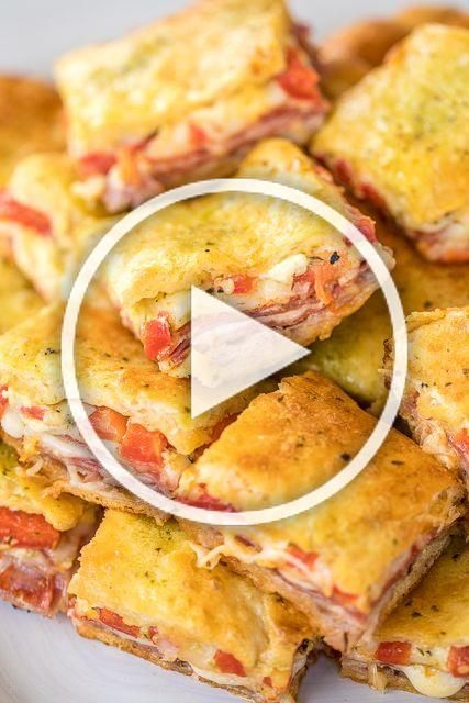 Antipasto Squares recipe - SO GOOD!! Crescent rolls stuffed with ham, salami, pepperoni, provolone, swiss, and roasted red peppers. then topped with a parmesan cheese, egg and pesto mixture and baked. These things are ridiculously good!!! There are never any leftovers when I take these to party! #appetizer #partyfood #crescentrolls #antipastosquares Antipasto Squares recipe - SO GOOD!! Crescent rolls stuffed with ham, salami, pepperoni, provolone, swiss, and roasted red peppers. then topped with #antipastosquares