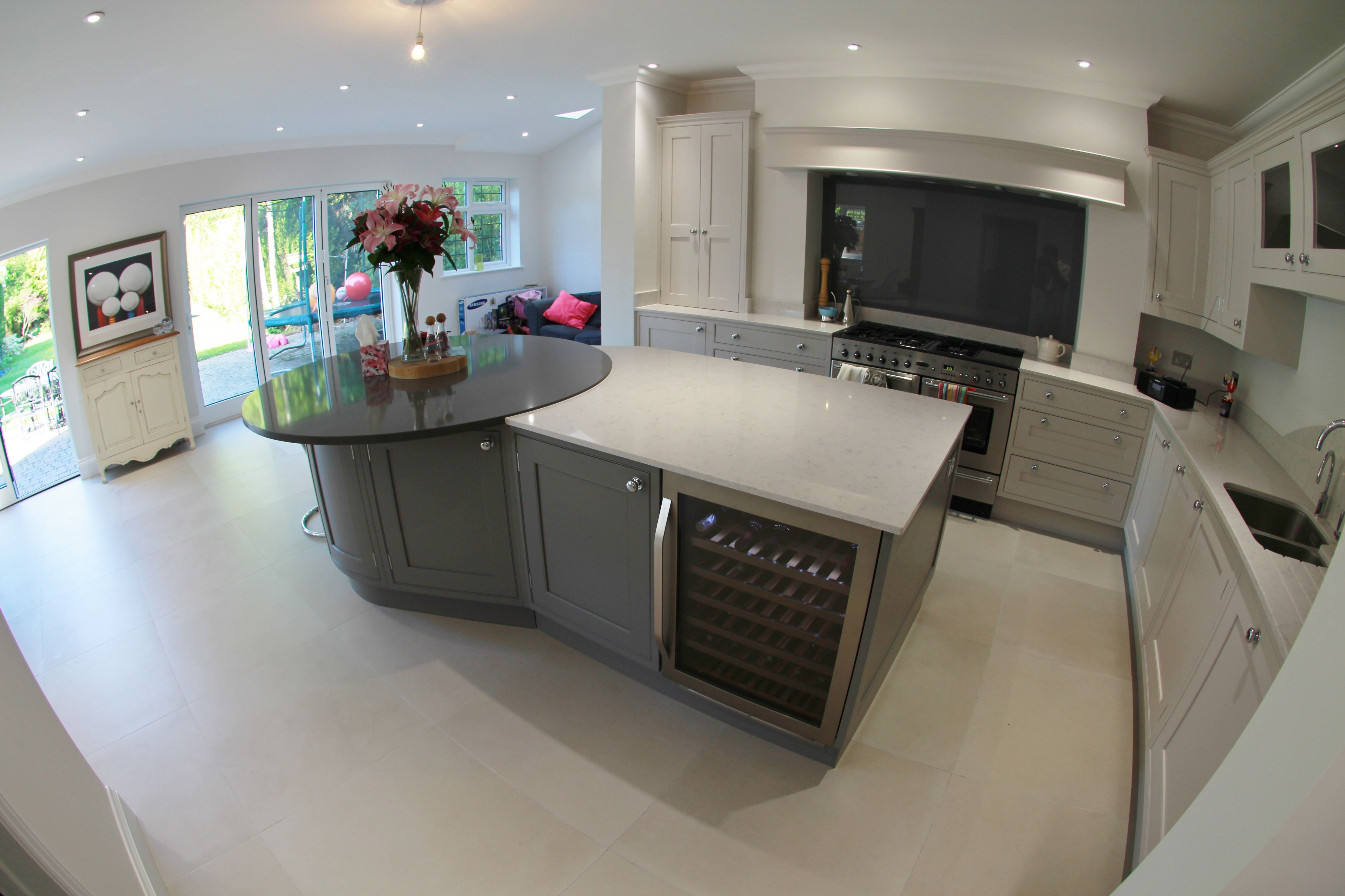 large kitchen island incorporating two different worktop shapes and colours includes wine. Black Bedroom Furniture Sets. Home Design Ideas