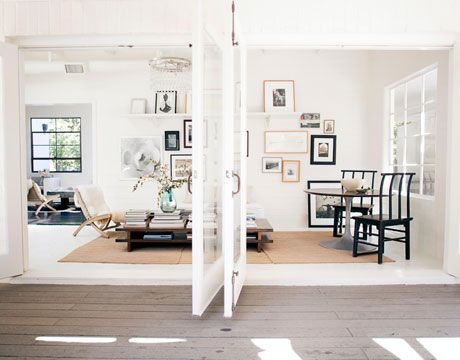 """obsessed - i would never leave, just read all day: The sunroom, part of the original 1952 house, is also the entrance. Photographer and owner Amy Neunsinger installed two pairs of double glass doors to create an indoor-outdoor flow. """"The room really feels more like a patio,"""" she says. The photographs include several taken by Neunsinger and her photo assistants. Antique Chinese chairs are paired with a vintage Saarinen table. Coffee table by Eric Troop; chandelier from Ochre. Walls are…"""