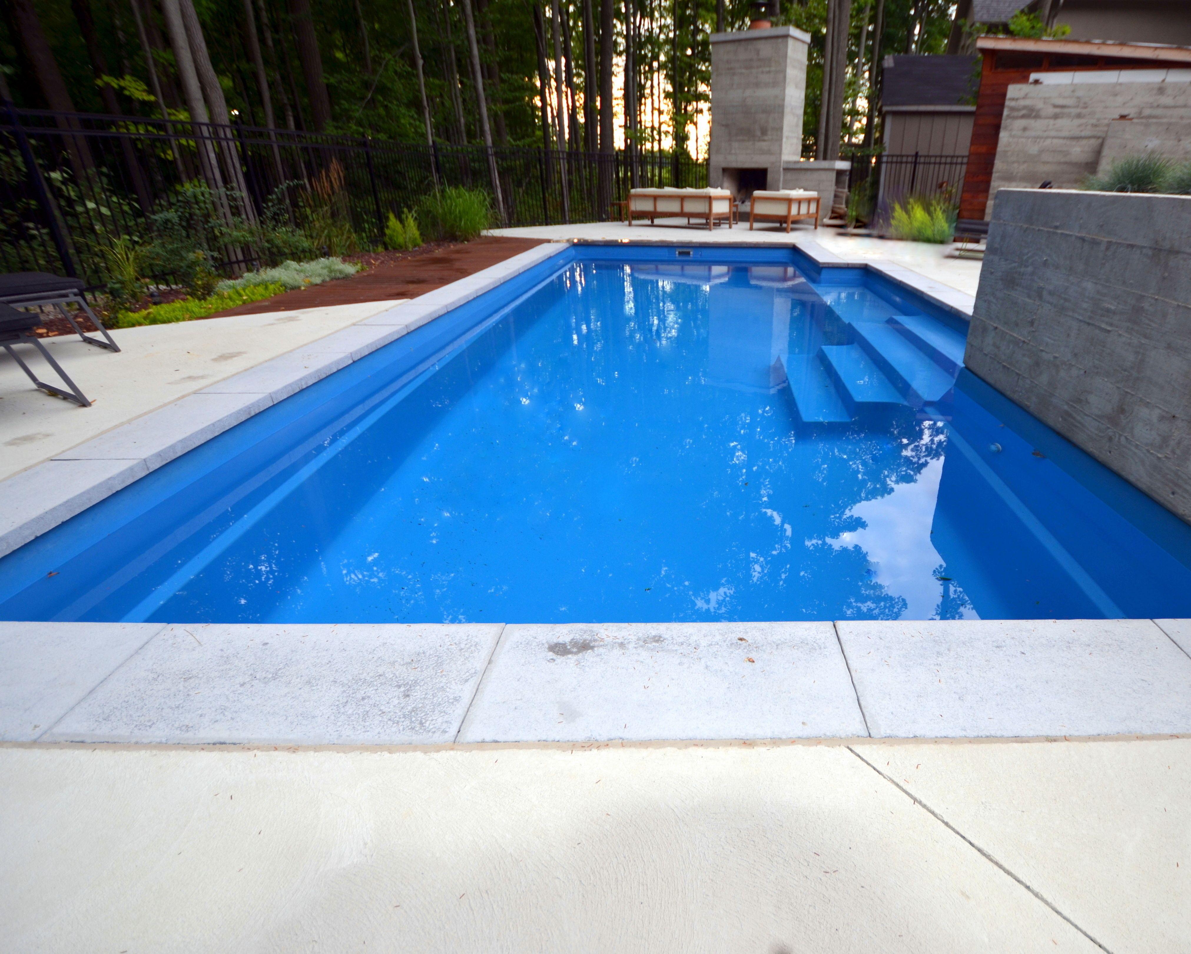 Natural Stone Coping On A Fiberglass Pool With Concrete Patio Pool Paving Pool Shapes Fiberglass Pools