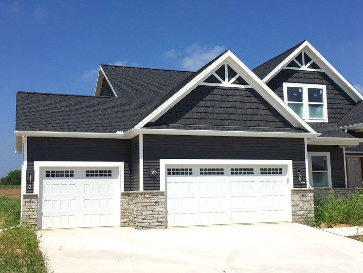 Royal ironstone dark grey siding and dark grey shakes decorative gable accents white trim - Black house with white trim ...