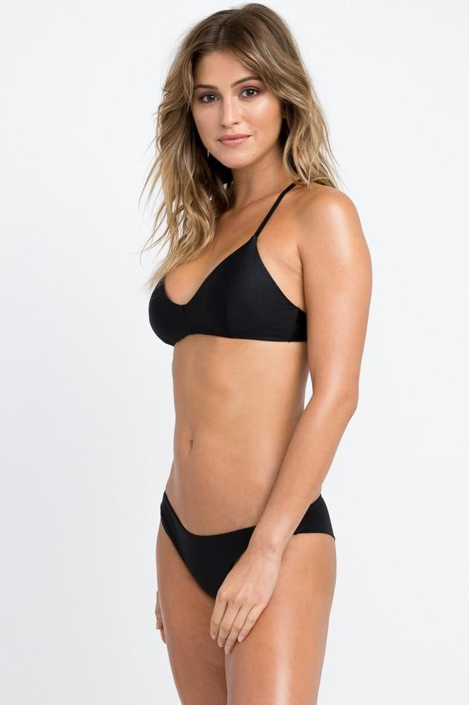 41b72aaa0c8 The RVCA Solid Cross Back Top is a sporty bralette-style swim bikini top  with