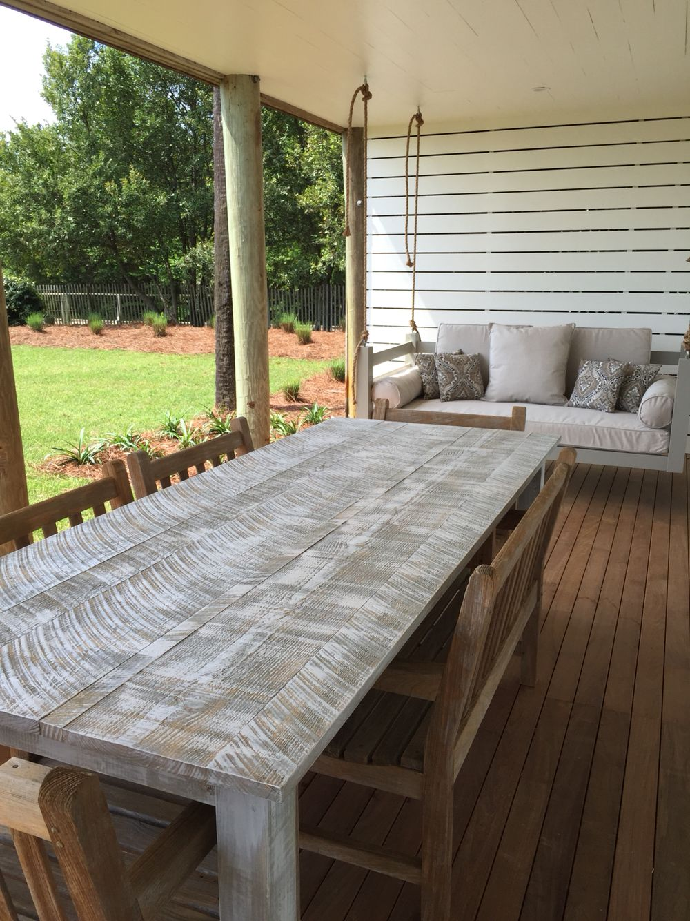 Farm table and swing bed by Lowcountry