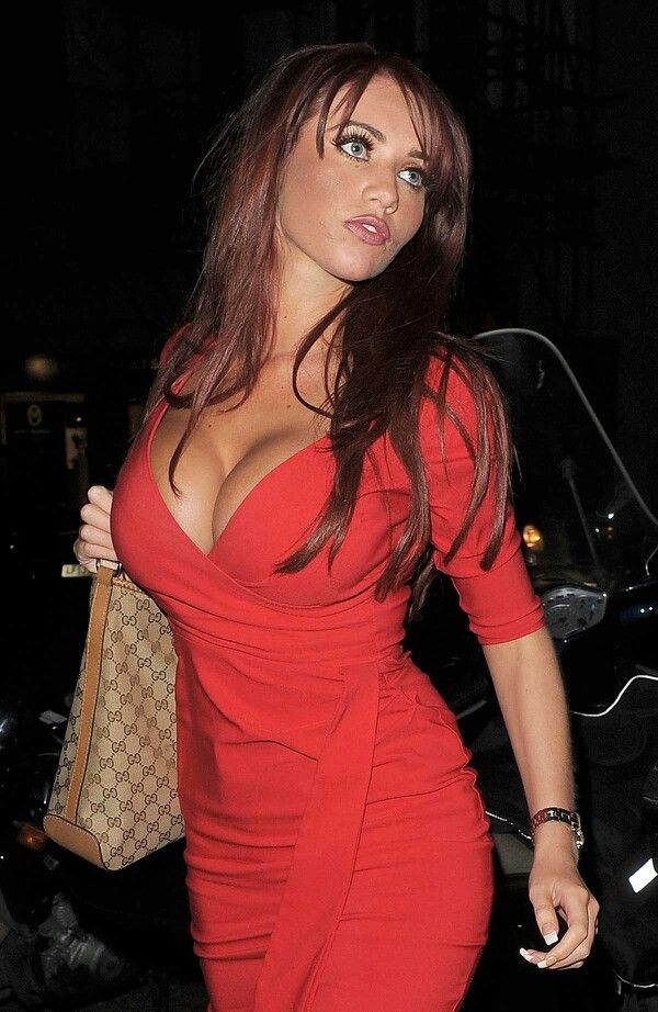 Amy Childs is festive in a bright red dress as she meets