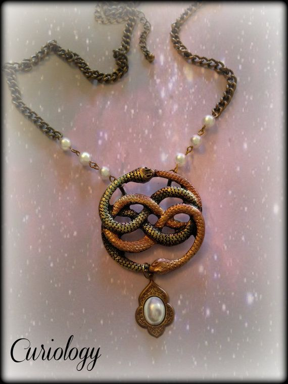 Never ending story auryn necklace with pearl by curiologystore never ending story auryn necklace with pearl by curiologystore 1500 mozeypictures Choice Image