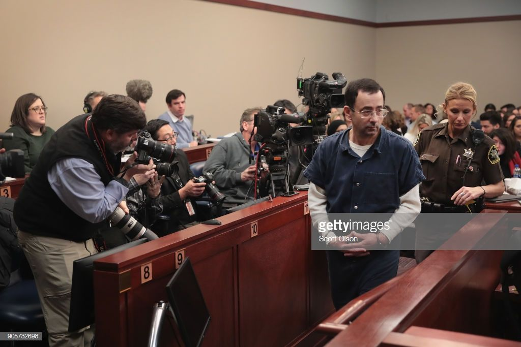 Larry Nassar walks into the courtroom to listen to victim