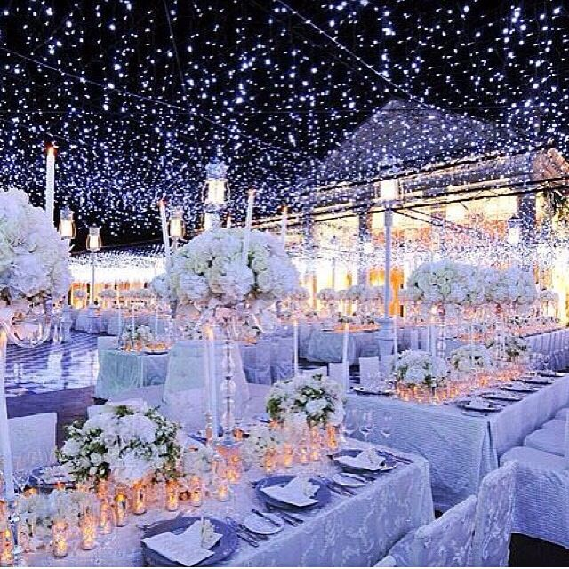 How To Create A Winter Wonderland Wedding Reception Decor Planning High Fl Topiaries Blue Lighting Wow The Ceiling